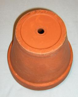 Clay Flower Pot, Upside Down to Show Hole in Bottom